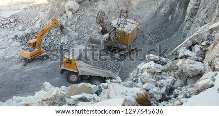 Heavy quarry machinery works in a stone quarry, top view, panorama. #1297645636
