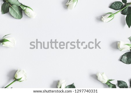 Flowers composition. White rose flowers on pastel gray background. Flat lay, top view, copy space #1297740331