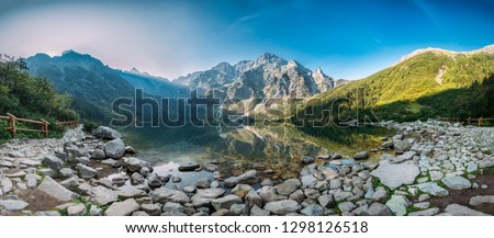 Tatra National Park, Poland. Panorama Famous Mountains Lake Morskie Oko Or Sea Eye Lake In Summer Morning. Five Lakes Valley. Beautiful Scenic View. UNESCO's World Network of Biosphere Reserves #1298126518