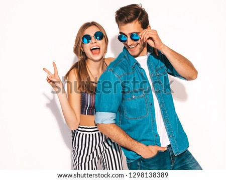 Portrait of Smiling Beautiful Girl and her Handsome Boyfriend laughing.Happy Cheerful Family in sunglasses.Valentine's Day. Isolated on white. Hugging #1298138389
