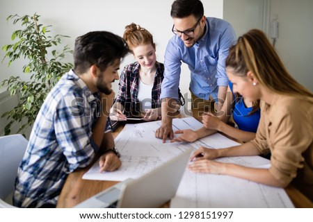 Portrait of architects having discussion in office #1298151997