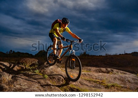 Cyclist Riding the Mountain Bike on the Rocky Trail in the Evening. Extreme Sport and Enduro Biking Concept. #1298152942