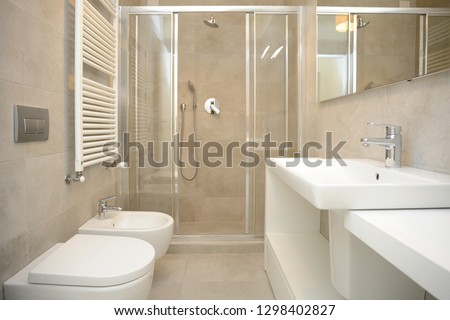 photo of renovated bathroom with shower, sanitary ware and modern sink - classic and elegant style #1298402827