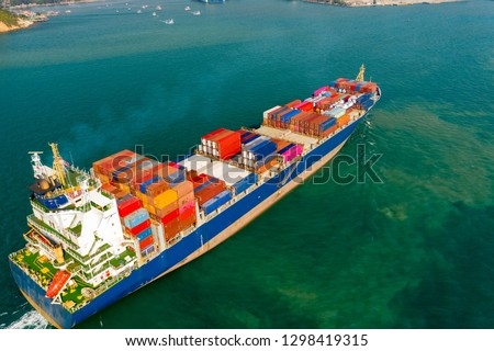 Aerial view. Container ship in pier with crane bridge carries out export and import business in the open sea. Logistics and transportation #1298419315