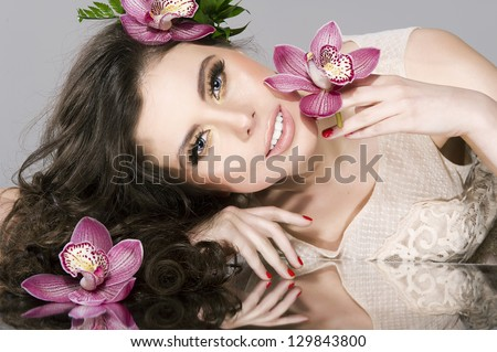 Beauty Girl With  Flowers.Beautiful Model Woman Face. Perfect Sk #129843800