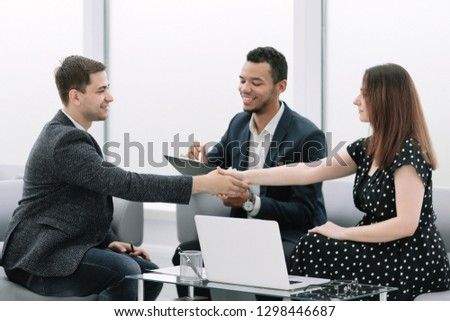 confident handshake of business partners at a business meeting #1298446687
