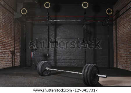 Workout gym with cross fit equipment. Barbell horizontal bars gymnastic rings. #1298459317