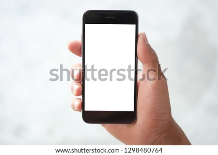 Cropped shot view of man hands holding smart phone with blank copy space screen for your text message or information content, female reading text message on cell telephone during in urban setting.  #1298480764