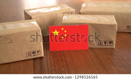 Package box with a flag of China. Online shopping. International E-commerce #1298526565