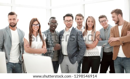 group of successful business people standing in the office #1298546914