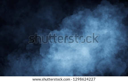 Dark-black room, street. Smoke on a black background, the light in the smoke.
