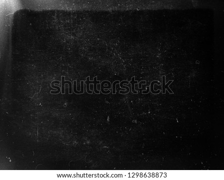Black scratched grunge scary background, old distressed texture with frame, old film effect #1298638873