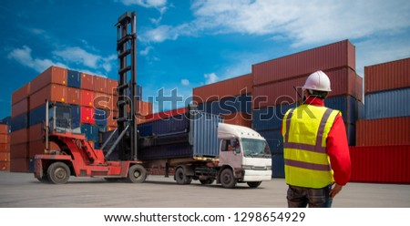 Foreman control loading containers box from cargo freight ship for import export, Foreman control industrial container cargo freight ship, Business logistic concept, Import and export concept #1298654929