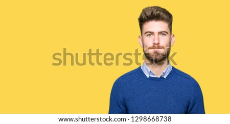 Young handsome bussines man puffing cheeks with funny face. Mouth inflated with air, crazy expression. #1298668738