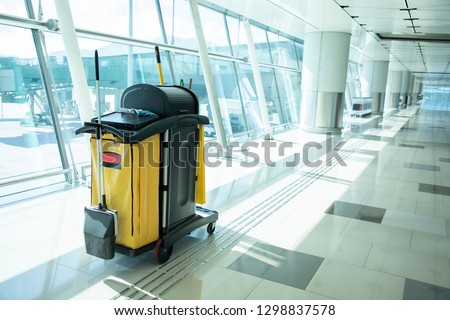 Cleaning tools cart wait for maid or cleaner in the airport. Bucket and set of cleaning equipment in the hospital. Concept of service, worker and equipment for cleaner and health #1298837578