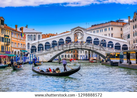 Rialto bridge and Grand Canal in Venice, Italy. View of Venice Grand Canal with gandola. Architecture and landmarks of Venice. Venice postcard #1298888572