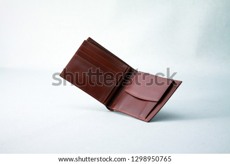 Genuine leather men's bifold wallet Royalty-Free Stock Photo #1298950765