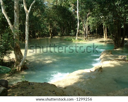 Dreamy emerald waterfall in the jungle, Laos, Southeast Asia #1299256