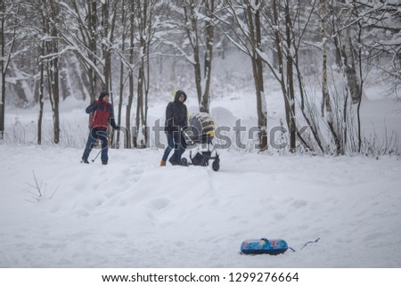 Russia, St. Petersburg, Shuvalov Park, 2 6.01.2019, walk with a stroller, in the winter Park, a child in the fresh air, a man with a stroller #1299276664