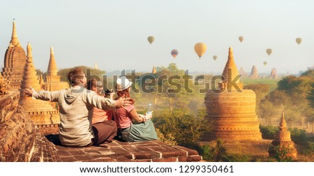 Happy tourists, friends, vacationers in the summer holidays in Old Bagan, Myanmar.Young people having fun traveling together. Travel, holiday, relationship and sport concept. #1299350461