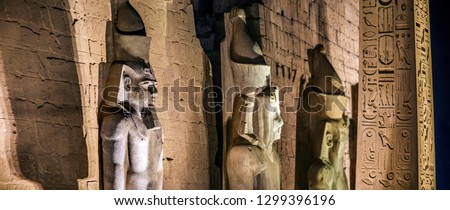 The entrance pylon of the Luxor Temple (Temple of Amun-Ra) in Luxor, Egypt. The enterance is highlighted by the obelisk and giant statues #1299396196