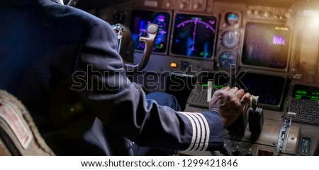Over the Shoulder of an African Pilot in a Jumbo Cockpit #1299421846