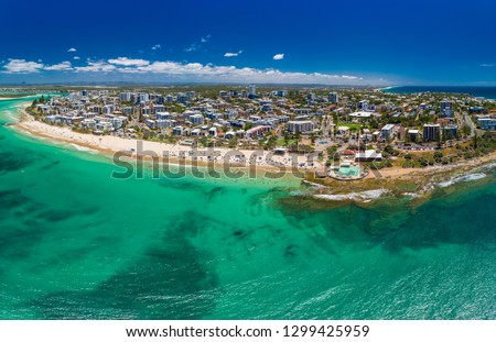 Aerial drone panoramic image of ocean waves on a busy Kings beach, Caloundra, Queensland, Australia #1299425959