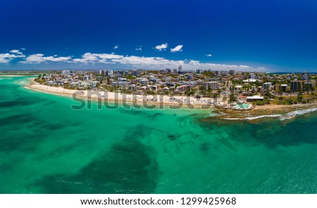 Aerial drone panoramic image of ocean waves on a busy Kings beach, Caloundra, Queensland, Australia #1299425968