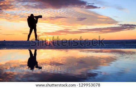 A photographer in sunset #129953078