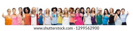 diversity and female unity concept - international group of happy smiling different women on white background showing thumbs up #1299562900