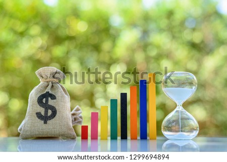 Term fund / time value of money / wealth creation, financial concept : US dollar bag, rising bar graph with hourglass, ideas about sustainable fund investment from private income for long term growth #1299694894