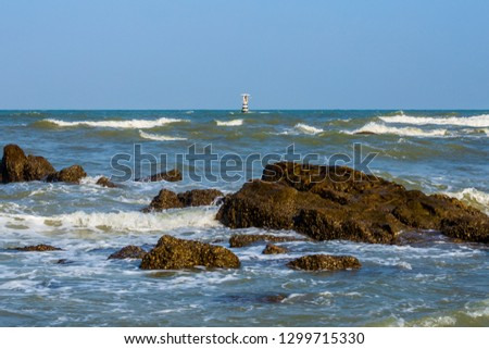 Summer time. Bright sunlight, wave, blue seawater and light blue sky, white lighthouse background. Peaceful place for summer holidays. Khao Lak, Andaman Sea, Thailand #1299715330