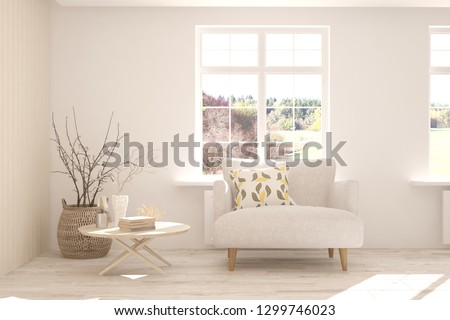 White stylish minimalist room with sofa and autumn landscape in window. Scandinavian interior design. 3D illustration #1299746023