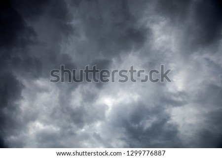 Dramatic dark sky with heavy overcast stormy clouds Royalty-Free Stock Photo #1299776887