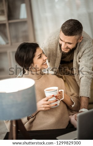 Content in internet. Romantic beautiful couple lovely looking on each other while spending time in cabinet #1299829300