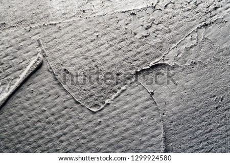 Painting brush strokes on a gray background. Close-up. Basis for web design, decor, text #1299924580
