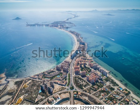 Aerial photo of buildings, villas and the beach on a natural spit of La Manga between the Mediterranean and the Mar Menor, Cartagena, Costa Blanca, Spain. 14
