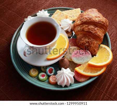 Cup of tea, croissant, cookies and sweets #1299950911