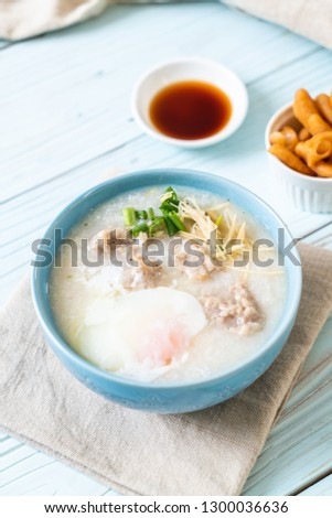 congee with minced pork in bowl - Asian breakfast style #1300036636