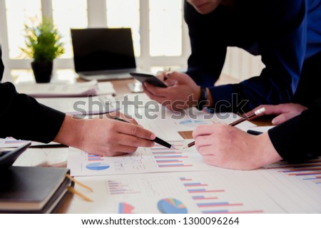 Team of business  investment consultant analyzing company annual financial report balance sheet statement working with documents graphs. Concept picture of economy, market, office, money and tax #1300096264