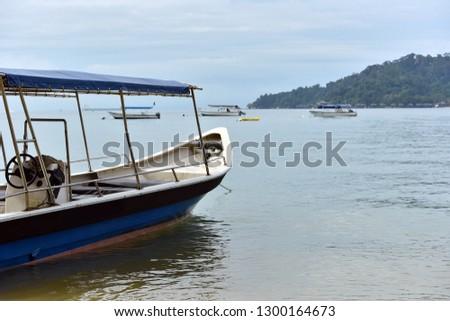 Tourist boat moored by the sea in Pulau Pangkor, Perak Malaysia #1300164673