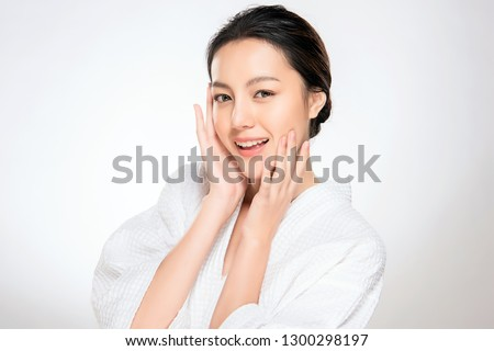 Beautiful Young asian Woman with Clean Fresh Skin look. Girl beauty face care. Facial treatment. Cosmetology, beauty and spa. #1300298197
