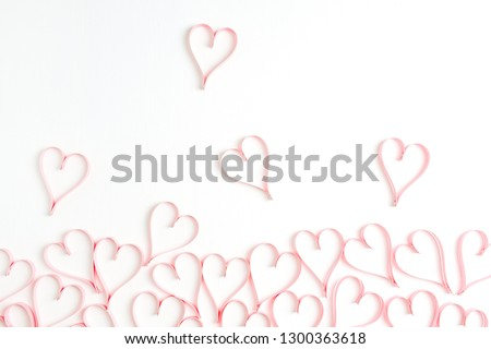 Paper heart symbols on white background. Flat lay, top view Valentines Day background love concept. #1300363618