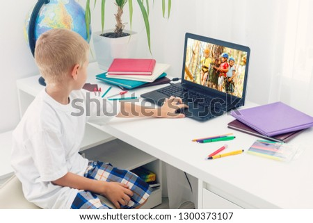 Happy boy sitting With laptop computer #1300373107