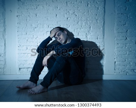 Portrait of sad depressed young man crying devastated feeling hurt suffering Depression in People, Sadness, Emotional pain, Loneliness and Heartbroken concept with copy space and dark mood light. #1300374493