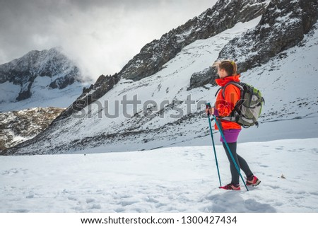 Young woman hiking in the mountains #1300427434