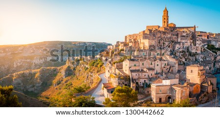 Panoramic view of the ancient town of Matera (Sassi di Matera) in beautiful golden morning light at sunrise, Basilicata, southern Italy #1300442662