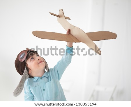 happy boy play in airplane  indoors #130053194