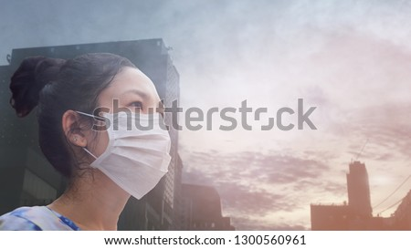women wearing facial hygienic mask for Safety outdoor. People in masks because of fine dust in thailand. Problems found in major cities around the world. air pollution,Environmental awareness concept #1300560961
