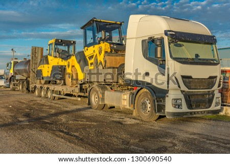 Road transport of heavy machinery in large trucks #1300690540
